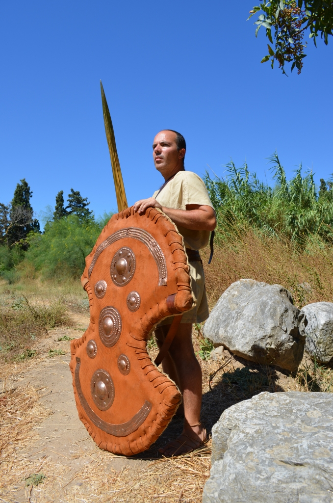 Mycaenean Anax (Land Lord), armed with Dipylon shield.  The shield reconstruction is based on a heavy frame (native Greek wicker wood) and heavy leather (cow). Additional decorated copper reinforcements are used on the exterior surface