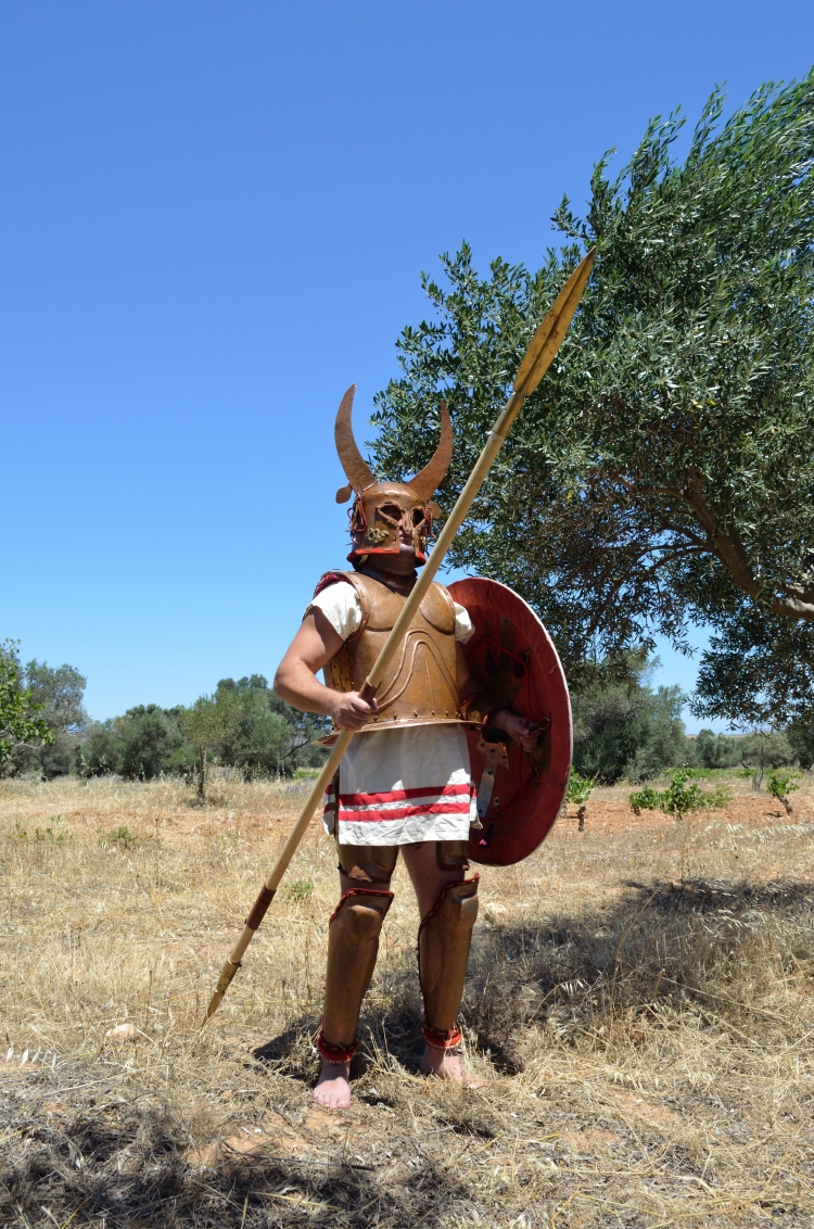 Fig. 71. Reconstruction of an Archaic Period Hoplite Armour, from the Greek Mainland. The bell cuirass and grieves are based on exhibits from the Olympia Museum and the Corinthian helmet on an item found in Tarento – now exhibited in the Geneva Museum of Art. Association of Historical Studies KORYVANTES