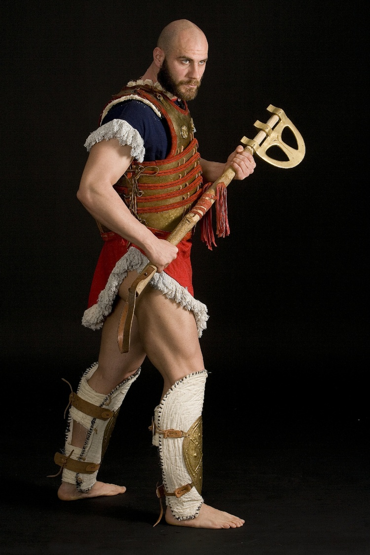 "Reconstruction of Mycenaean Warrior Armour of Late Bronze Age Era (1300-1200 BC)from a Middle Eastern Colony. The Armour is based onan interpretation of the ""Pylos tablets"" and the newly discovered ""Thebes Arsenal"". The ""Epsilon Blade"" Axe is based on exhibits  from the National Archaeological Museum . This type of axe was  used in the eastern Mediteranean from the 2nd millenium BC and could cause serious damages to the enemy . The man noted as ""6000"" from the  Hagios Charalambos cave in Crete could have injured by such a weapon."