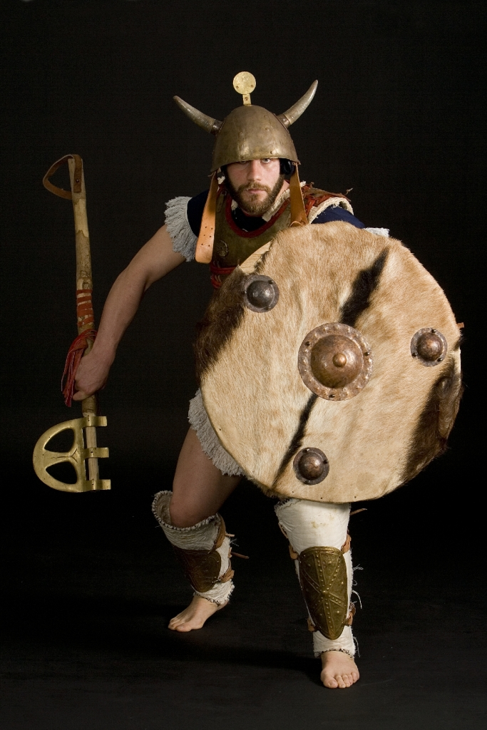 Sea People warrior, armed with heavy Mycaenean Epsilon-type axe. Reconstruction by Hellenicarmors, of a Sea People Armour and weapons, of the Dark ages. The cuirass is based on depiction from Medinet Habu, Mortuary Temple of Ramesses III, Luxor. Heavy, Epsilon-type axe and grieves are based on various Mycaenean artifacts of Greek Archeological Museums. Association of Historical Studies KORYVANTES. Photo: Andreas Smaragdis