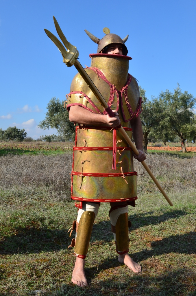 Early Mycaenean warrior, armed with Naumahon Xisto (?) - boarding pike (Ιλ. Ο. 388 - 389, 676 - 78). Reconstruction by Hellenicarmors, of a Mycaenean armor and weapons. The Mycaenean plate armor is an exact copy (onlly scale is different to fit to 1.85 tall man) of the Dendra armor, presented in Nafplion Archeological Museum. The peculiar bronze double-headed blade is dated around 16th Century BC found at Agios Onoufrios near Phaistos Crete. A reference about this kind of double-head spear and its utilization related with the boats is also present in the Iliad during the battle inside the Achaeans camp just around the ships (Iliad XV, 712). The helmet is based on depiction from Medinet Habu, Mortuary Temple of Ramesses III, Luxor. Association of Historical Studies KORYVANTES