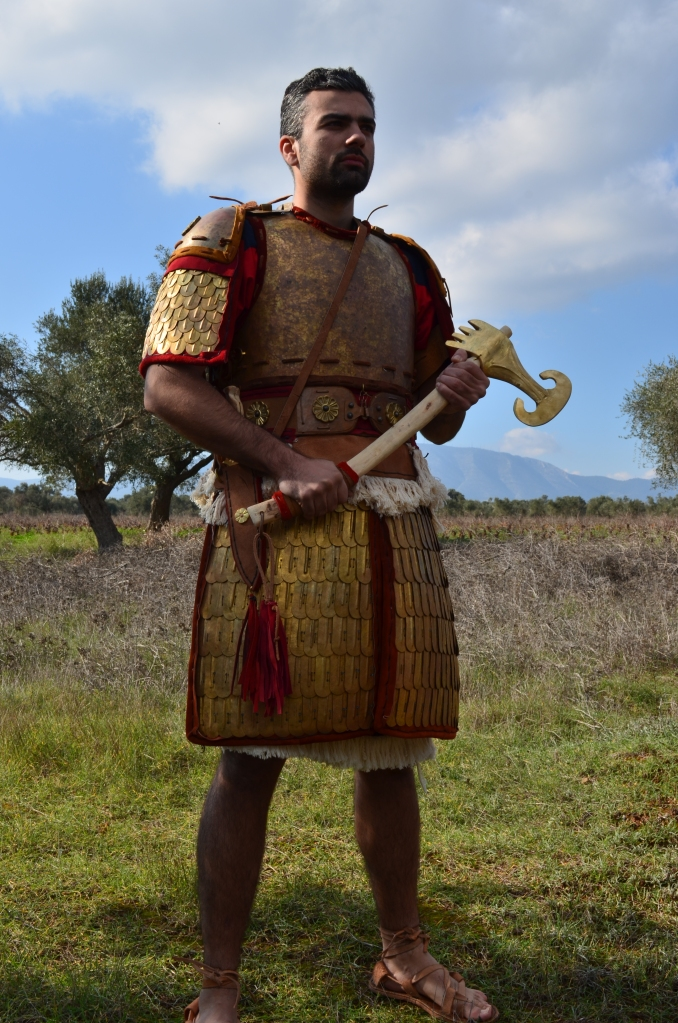 Hittite warrior, armed with axe. Reconstruction by Hellenicarmors, of an Hittite armor and weapons of the Hattusa Kingdom. The hybrid cuirass combines elements of Hittite / Assyrian / Egypt scale armors and Mycaenean plate armor. Axe, based on depiction of King's Gate at Hattusa, is shaped like warthog teeths. Association of Historical Studies KORYVANTES